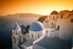 Oia village. The churches, caldera and village at Oia, Santorini, under a dramatic, surreal sky Royalty Free Stock Photos
