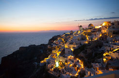 Oia village by night in Santorini island Royalty Free Stock Photography