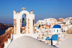 Oia Village Santorini Bell tower, Greece. Oia Village Santorini, focus Bell tower with blue domes in background. Greece Royalty Free Stock Photography
