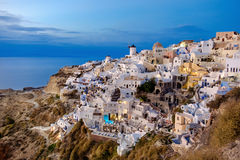 Oia village in Santorini in in the evening Royalty Free Stock Photos