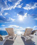 Oia village with sunbeds on Santorini island in Greece Royalty Free Stock Photography