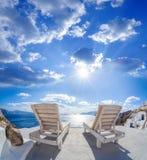 Oia village with sunbeds on Santorini island in Greece Stock Photography