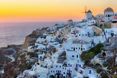 Oia village sunset in Santorini island Stock Photos