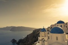 Oia village at sunset in santorini island, Greece Royalty Free Stock Photos