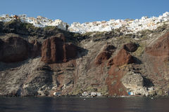 Oia village. Perched on top of steep high cliffs on the island of Santorini, Greece royalty free stock photography
