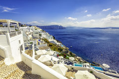 Oia village with white houses in Santorini Island Stock Photos