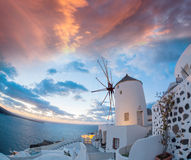 Oia village with windmill on Santorini island in Greece Stock Photography