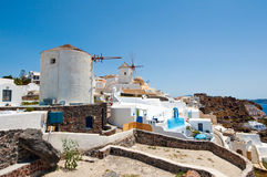 Oia windmills on the island of Santorini (Thira). Cyclades in Greece. Royalty Free Stock Images