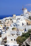 Oia Windmills - Santorini Island. View of windmills in Oia in a summer day Royalty Free Stock Images
