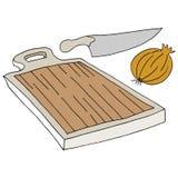 Oignon de couteau de planche à découper Photo stock