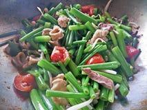 Oignons frits thaïlandais avec du porc Images libres de droits