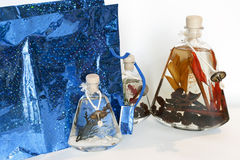 Oil. Packet with decorative bottles of aromatic oil Stock Image