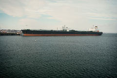 Oil. A large oil tanker, docked stock images