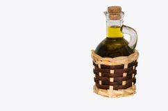 Oil. Olive oil in a small jug on a white background Stock Image