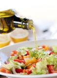 Oil is added into a salad Royalty Free Stock Image