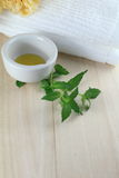 Oil for alternative treatment. Oil prepared for aroma therapy with towel Stock Images