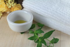 Oil for alternative treatment. Oil prepared for aroma therapy with towel Stock Photos