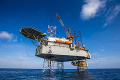 Oil And Gas Drilling Rig Working On Remote Wellhead Platform, Prepare To Transfer Passenger By Personal Basket Royalty Free Stock Images