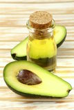 Oil of avocado and fresh fruit Stock Images