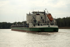 Oil barge. The Volga-Baltic waterway. Oil barge on the river Kovzha Royalty Free Stock Image
