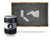 Oil barrel handshake icon on blackboard with Stock Photos