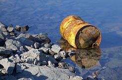 Oil barrel on water basin Liptovska Mara Stock Image