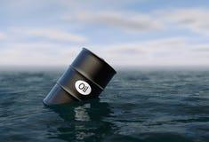 Oil barrel in water. price oil down. Stock Photos