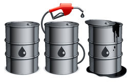 Oil barrels. Three metal barrels with gas pump and spilled oil Royalty Free Stock Image