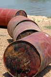 Oil Barrels. Discarded row of oil barrels Royalty Free Stock Photo