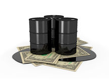 Oil barrels on dollar notes Stock Photo