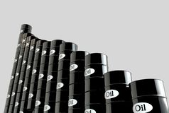 Oil barrels and a financial chart on white background.  price oil down.  business concept.  Stock Image