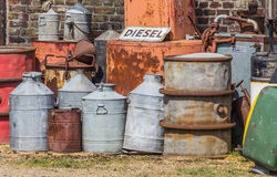 Oil barrels and gas pump. In a junk yard Royalty Free Stock Photography