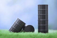Oil barrels in the grassland stock image