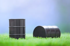 Oil barrels in the grassland Royalty Free Stock Photos