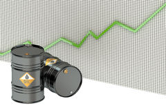 Oil barrels with green chart Royalty Free Stock Images