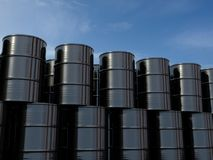 Oil barrels isolated on blue sky. 3d illustration. Arranged in a row royalty free illustration