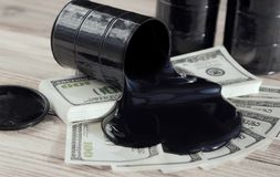 Oil barrels and poured money dollar currency. bargaining. Exchange. oil business. Profit income. market. prices rise, profit from sales of petroleum products Royalty Free Stock Photos