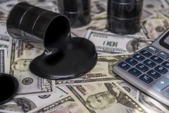 Oil against the background of dollar bills. fuel industry. Oil and barrels. poured oil on the money dollar currency. bargaining. Exchange. oil business. Profit Stock Photography