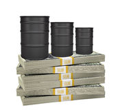Oil barrels on stack of money Royalty Free Stock Photography