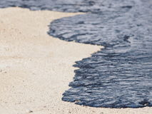 Oil on beach Royalty Free Stock Photography