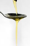 Oil being poured onto a spoon Royalty Free Stock Photography