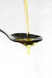 Oil being poured onto a spoon Stock Photo