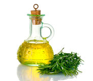 Oil in a bottle and fresh rosemary Stock Photography