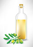 Oil bottle and olive branch Royalty Free Stock Photography