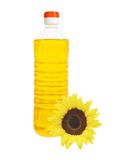 Oil in bottle and sunflower isolated Stock Photo