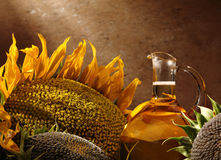 Oil bottle with sunflowers Stock Images