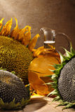 Oil bottle with sunflowers Stock Image