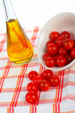 Oil bottle and tomatos cherry Stock Photography