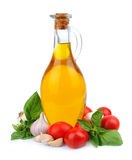 Oil bottle with vegetables Royalty Free Stock Photo