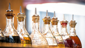 Oil bottles. Bottles with oil at a restaurant in italy (near rome Royalty Free Stock Image